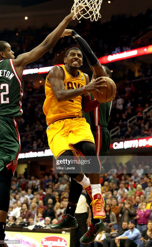 Kyrie Irving #2 of the Cleveland Cavaliers drives to the basket against Khris Middleton #22 of the Milwaukee Bucks in the fourt quarter at Quicken Loans Arena on December 20, 2013 in Cleveland, Ohio.