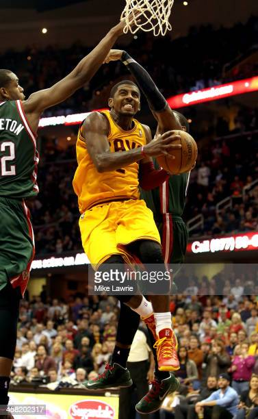 Kyrie Irving of the Cleveland Cavaliers drives to the basket against Khris Middleton of the Milwaukee Bucks in the fourt quarter at Quicken Loans...