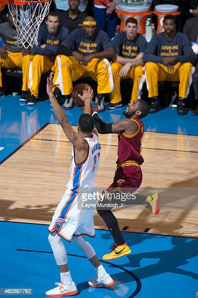 Kyrie Irving of the Cleveland Cavaliers drives to the basket against the Oklahoma City Thunder during an NBA game on December 11 2014 at the...