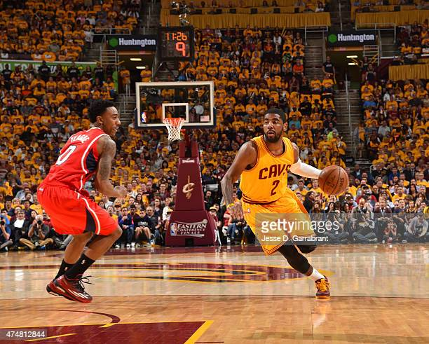 Kyrie Irving of the Cleveland Cavaliers drives to the basket against the Atlanta Hawks at the Quicken Loans Arena During Game Four of the Eastern...