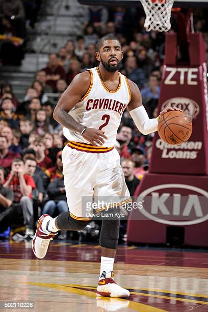 Kyrie Irving of the Cleveland Cavaliers drives to the basket against the Philadelphia 76ers during the game on December 20 2015 at Quicken Loans...