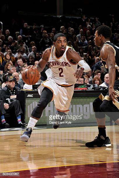Kyrie Irving of the Cleveland Cavaliers drives to the basket against the Toronto Raptors on January 4 2016 at Quicken Loans Arena in Cleveland Ohio...