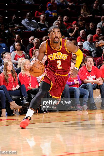 Kyrie Irving of the Cleveland Cavaliers drives to the basket against the Houston Rockets during the game on January 15 2016 at Toyota Center in...