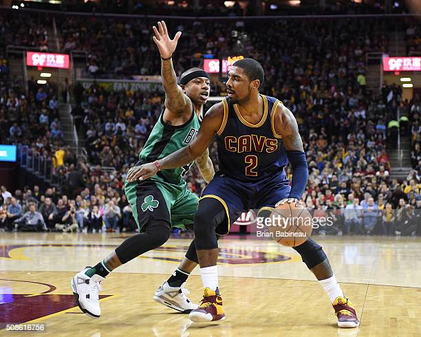 Kyrie Irving of the Cleveland Cavaliers drives to the basket against Isaiah Thomas of the Boston Celtics during the game on February 5 2016 at...
