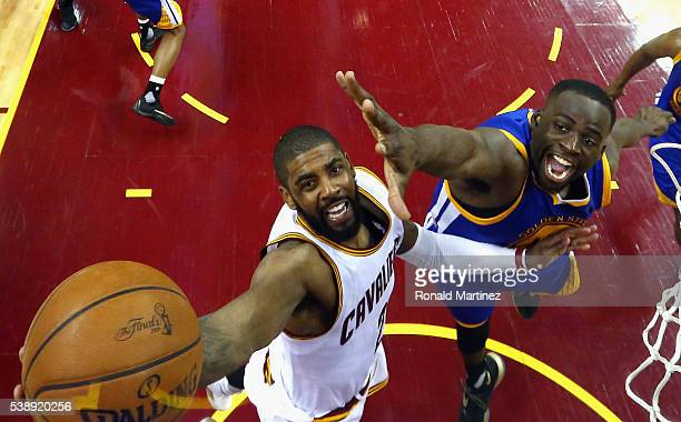 Kyrie Irving of the Cleveland Cavaliers drives to the basket against Draymond Green of the Golden State Warriors during the second half in Game 3 of...