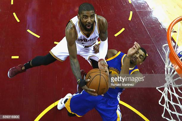 Kyrie Irving of the Cleveland Cavaliers drives to the basket against James Michael McAdoo of the Golden State Warriors during the second half in Game...