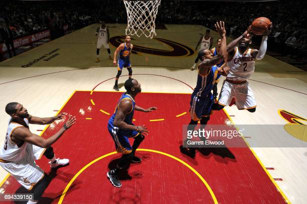 Kyrie Irving of the Cleveland Cavaliers drives to the basket against the Golden State Warriors in Game Four of the 2017 NBA Finals on June 9 2017 at...