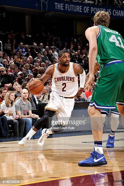 Kyrie Irving of the Cleveland Cavaliers drives to the basket during the game against the Dallas Mavericks on March 16 2016 at Quicken Loans Arena in...