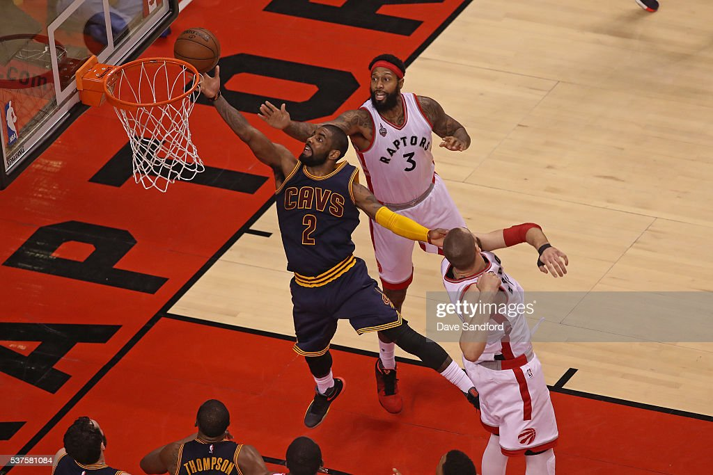 Kyrie Irving of the Cleveland Cavaliers drives to the basket in Game Six of the NBA Eastern Conference Finals against the Toronto Raptors at Air...