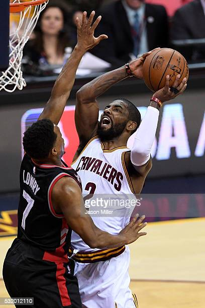 Kyrie Irving of the Cleveland Cavaliers drives to the basket in the first quarter against Kyle Lowry of the Toronto Raptors in game one of the...