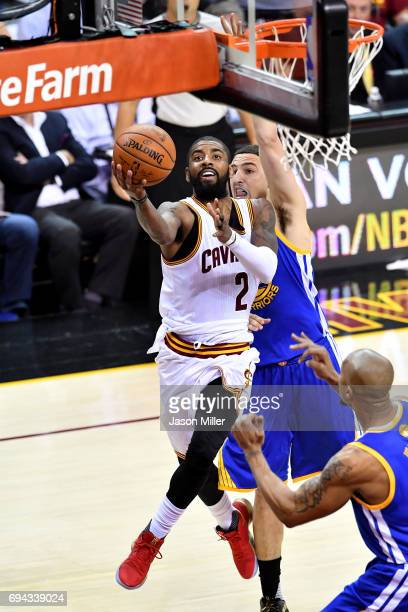Kyrie Irving of the Cleveland Cavaliers drives to the basket in the second quarter against Klay Thompson of the Golden State Warriors in Game 4 of...