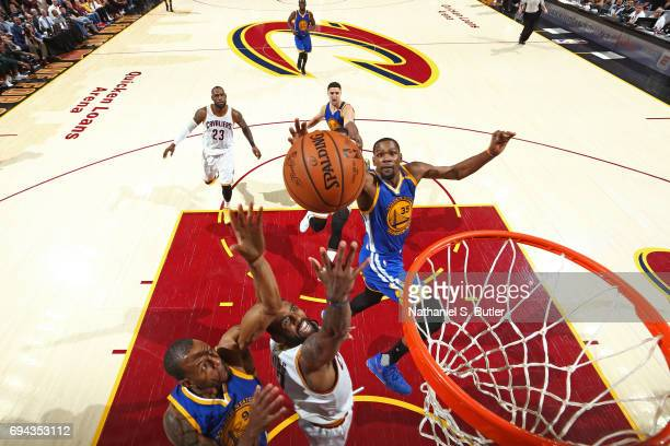 Kyrie Irving of the Cleveland Cavaliers drives to the basket while defended by Kevin Durant of the Golden State Warriors in Game Four of the 2017 NBA...