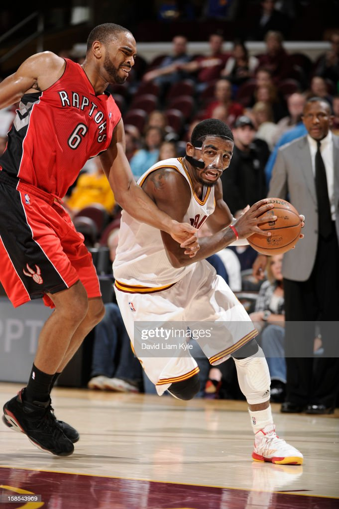 <a gi-track='captionPersonalityLinkClicked' href=/galleries/search?phrase=Kyrie+Irving&family=editorial&specificpeople=6893971 ng-click='$event.stopPropagation()'>Kyrie Irving</a> #2 of the Cleveland Cavaliers drives to the hoop against <a gi-track='captionPersonalityLinkClicked' href=/galleries/search?phrase=Alan+Anderson&family=editorial&specificpeople=3945355 ng-click='$event.stopPropagation()'>Alan Anderson</a> #6 of the Toronto Raptors at The Quicken Loans Arena on December 18, 2012 in Cleveland, Ohio.
