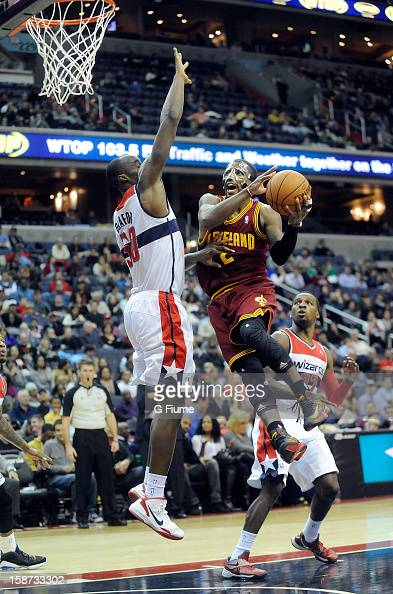 Kyrie Irving of the Cleveland Cavaliers drives to the hoop against Emeka Okafor of the Washington Wizards at the Verizon Center on December 26 2012...