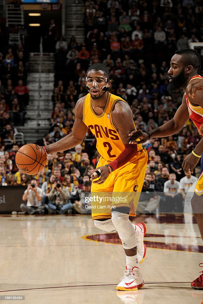 Kyrie Irving #2 of the Cleveland Cavaliers drives to the hoop against James Harden #13 of the Houston Rockets at The Quicken Loans Arena on January 5, 2013 in Cleveland, Ohio.