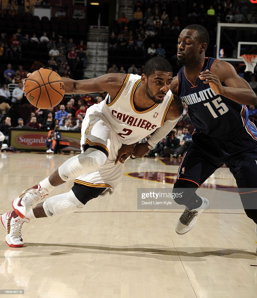 Kyrie Irving #2 of the Cleveland Cavaliers drives to the hoop against Kemba Walker #15 of the Charlotte Bobcats at The Quicken Loans Arena on February 6, 2013 in Cleveland, Ohio.