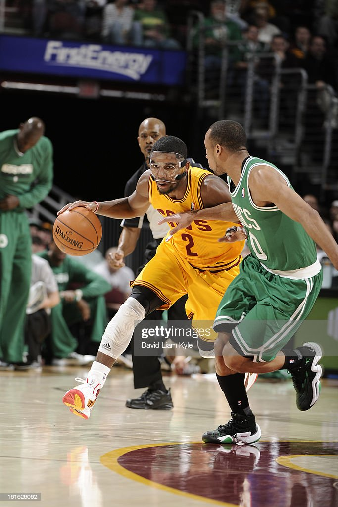 <a gi-track='captionPersonalityLinkClicked' href=/galleries/search?phrase=Kyrie+Irving&family=editorial&specificpeople=6893971 ng-click='$event.stopPropagation()'>Kyrie Irving</a> #2 of the Cleveland Cavaliers drives to the hoop against the Boston Celtics at The Quicken Loans Arena on January 22, 2013 in Cleveland, Ohio.