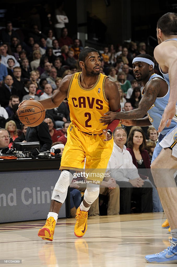 Kyrie Irving #2 of the Cleveland Cavaliers drives to the hoop against Ty Lawson #3 of the Denver Nuggets at The Quicken Loans Arena on February 9, 2013 in Cleveland, Ohio.
