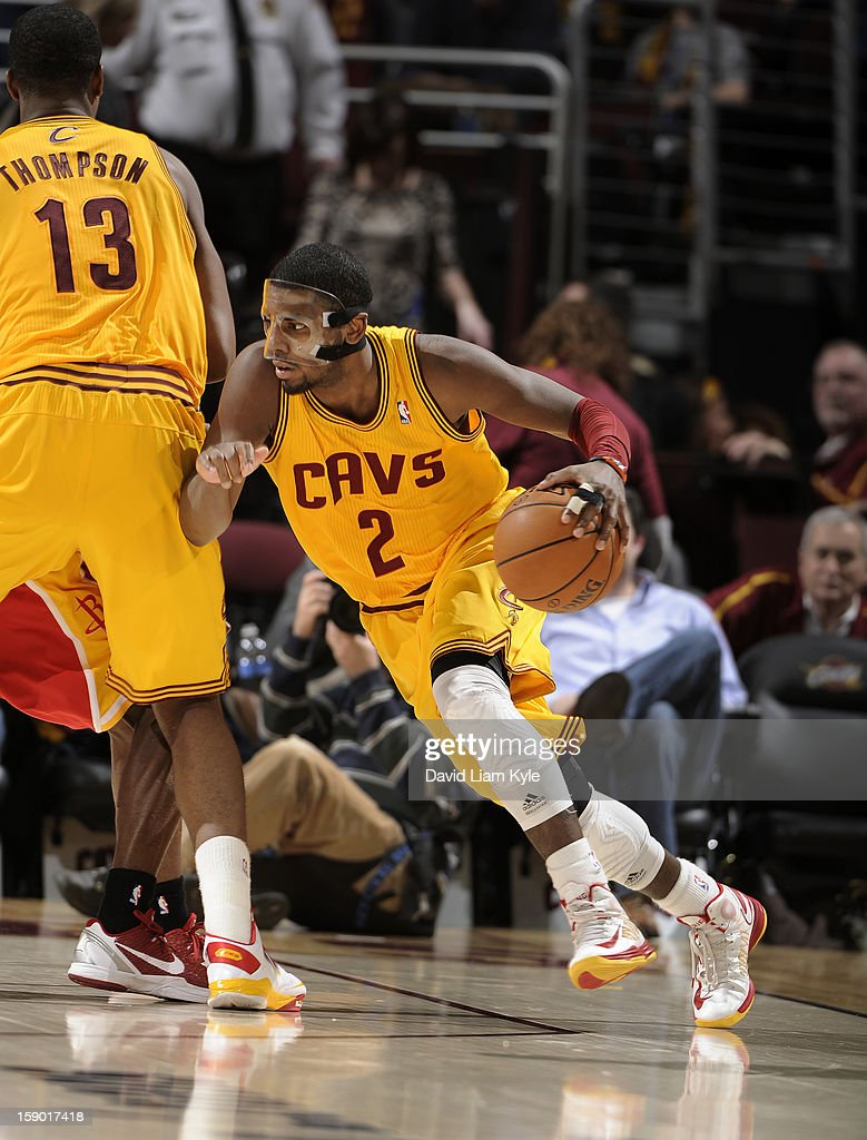 <a gi-track='captionPersonalityLinkClicked' href=/galleries/search?phrase=Kyrie+Irving&family=editorial&specificpeople=6893971 ng-click='$event.stopPropagation()'>Kyrie Irving</a> #2 of the Cleveland Cavaliers drives to the hoop with the help of a pick by teammate <a gi-track='captionPersonalityLinkClicked' href=/galleries/search?phrase=Tristan+Thompson&family=editorial&specificpeople=5799092 ng-click='$event.stopPropagation()'>Tristan Thompson</a> #13 in the game against the Houston Rockets at The Quicken Loans Arena on January 5, 2013 in Cleveland, Ohio.