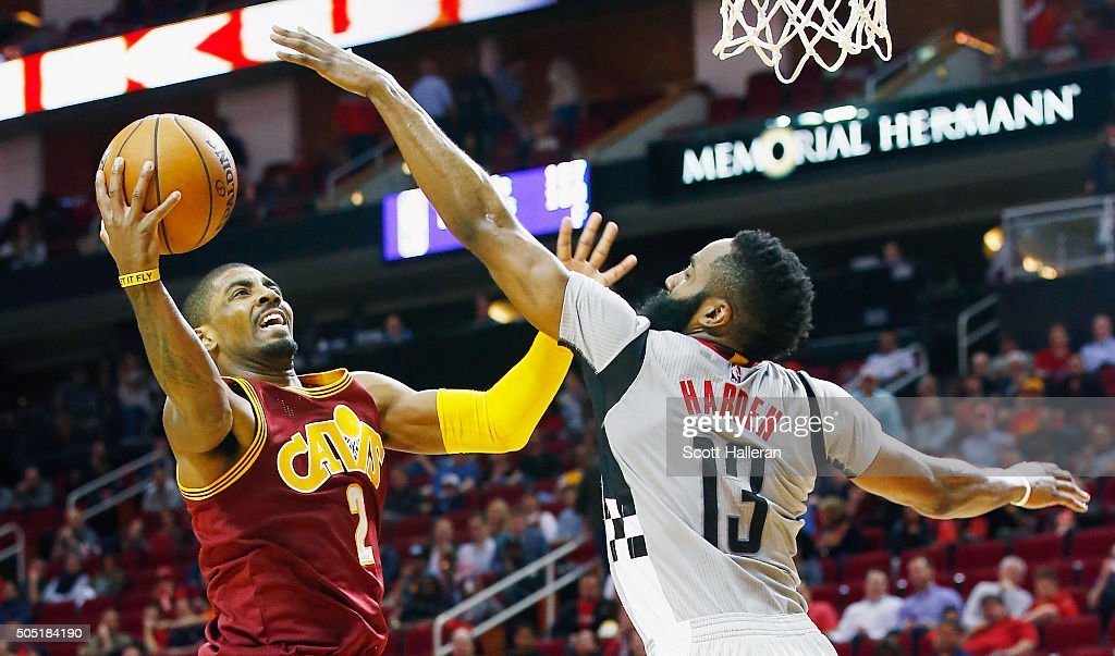 Kyrie Irving #2 of the Cleveland Cavaliers drives with the ball against James Harden #13 of the Houston Rockets during their game at the Toyota Center on January 15, 2016 in Houston, Texas.