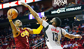 Kyrie Irving of the Cleveland Cavaliers drives with the ball against James Harden of the Houston Rockets during their game at the Toyota Center on...