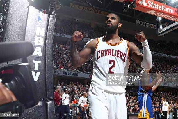 Kyrie Irving of the Cleveland Cavaliers flexes and celebrates in Game Four of the 2017 NBA Finals against the Golden State Warriors on June 9 2017 at...