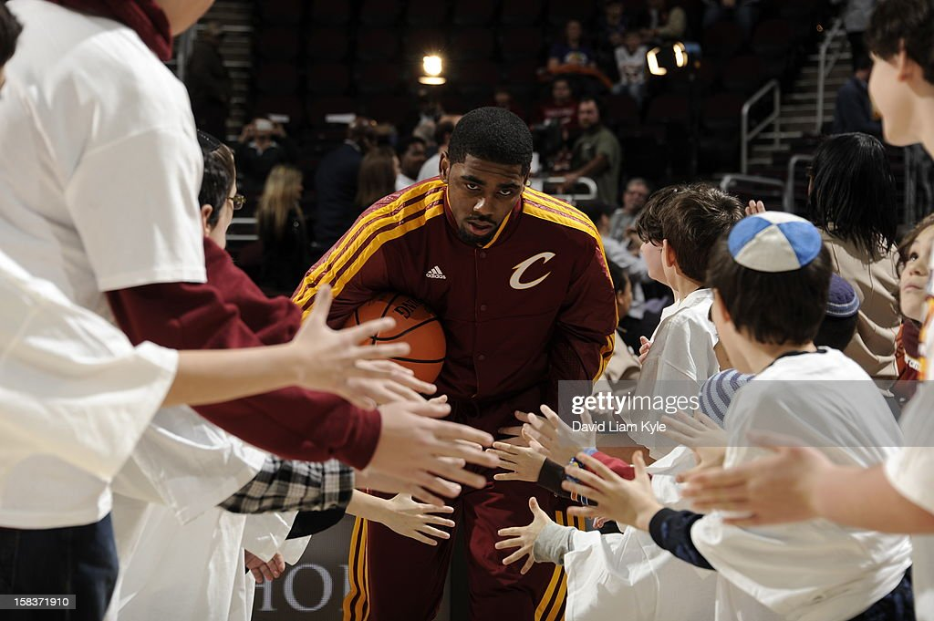 <a gi-track='captionPersonalityLinkClicked' href=/galleries/search?phrase=Kyrie+Irving&family=editorial&specificpeople=6893971 ng-click='$event.stopPropagation()'>Kyrie Irving</a> #2 of the Cleveland Cavaliers gets introduced before the game against the Los Angeles Lakers at The Quicken Loans Arena on December 11, 2012 in Cleveland, Ohio.