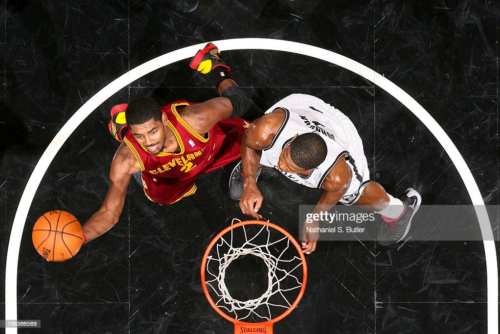 Kyrie Irving #2 of the Cleveland Cavaliers goes to the basket against C.J. Watson #1 of the Brooklyn Nets on November 13, 2012 at the Barclays Center in the Brooklyn Borough of New York City.