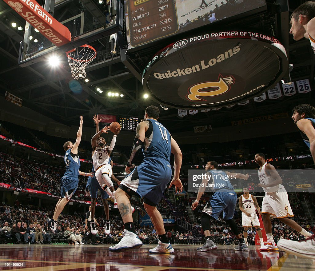 <a gi-track='captionPersonalityLinkClicked' href=/galleries/search?phrase=Kyrie+Irving&family=editorial&specificpeople=6893971 ng-click='$event.stopPropagation()'>Kyrie Irving</a> #2 of the Cleveland Cavaliers goes to the basket against <a gi-track='captionPersonalityLinkClicked' href=/galleries/search?phrase=Luke+Ridnour&family=editorial&specificpeople=201824 ng-click='$event.stopPropagation()'>Luke Ridnour</a> #13 of the Minnesota Timberwolves at The Quicken Loans Arena on February 11, 2013 in Cleveland, Ohio.