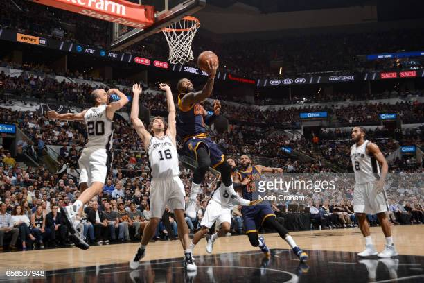 Kyrie Irving of the Cleveland Cavaliers goes to the basket against the San Antonio Spurs on March 27 2017 at the ATT Center in San Antonio Texas NOTE...