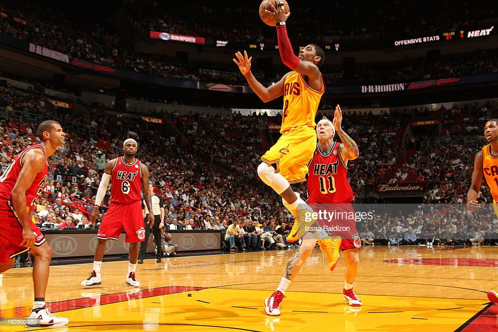 <a gi-track='captionPersonalityLinkClicked' href=/galleries/search?phrase=Kyrie+Irving&family=editorial&specificpeople=6893971 ng-click='$event.stopPropagation()'>Kyrie Irving</a> #2 of the Cleveland Cavaliers goes to the basket during a game between the Cleveland Cavaliers and the Miami Heat on February 24, 2013 at American Airlines Arena in Miami, Florida.