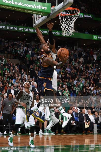 Kyrie Irving of the Cleveland Cavaliers goes up for a lay up against the Boston Celtics on March 1 2017 at the TD Garden in Boston Massachusetts NOTE...