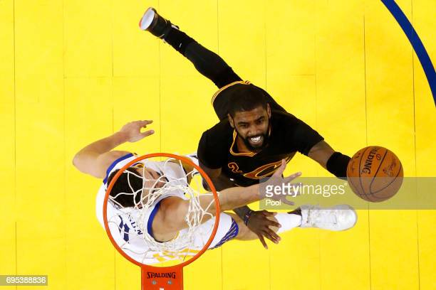 Kyrie Irving of the Cleveland Cavaliers goes up for a shot against Klay Thompson of the Golden State Warriors in Game 5 of the 2017 NBA Finals at...