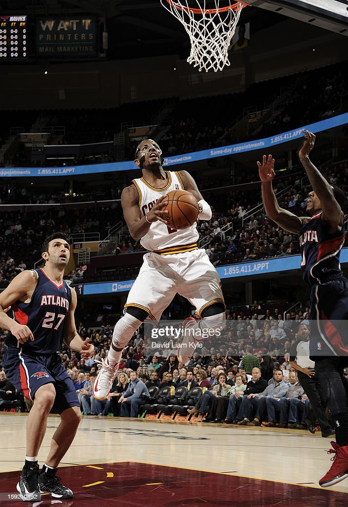 Kyrie Irving #2 of the Cleveland Cavaliers goes up for the shot against Jeff Teague #0 of the Atlanta Hawks at The Quicken Loans Arena on January 9, 2013 in Cleveland, Ohio.