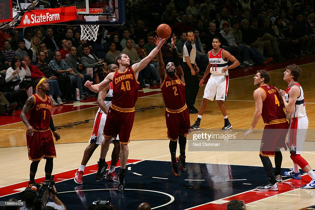 <a gi-track='captionPersonalityLinkClicked' href=/galleries/search?phrase=Kyrie+Irving&family=editorial&specificpeople=6893971 ng-click='$event.stopPropagation()'>Kyrie Irving</a> #2 of the Cleveland Cavaliers grabs a rebound against the Washington Wizards at the Verizon Center on December 26, 2012 in Washington, DC.