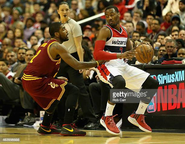 Kyrie Irving of the Cleveland Cavaliers guards John Wall of the Washington Wizards during the first half at Verizon Center on February 20 2015 in...