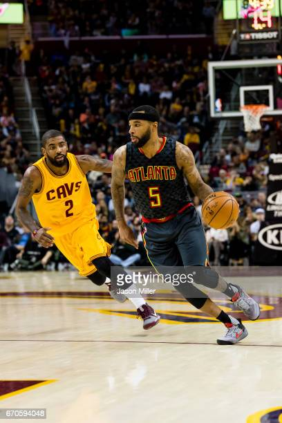 Kyrie Irving of the Cleveland Cavaliers guards Malcolm Delaney of the Atlanta Hawks during the second half at Quicken Loans Arena on April 7 2017 in...
