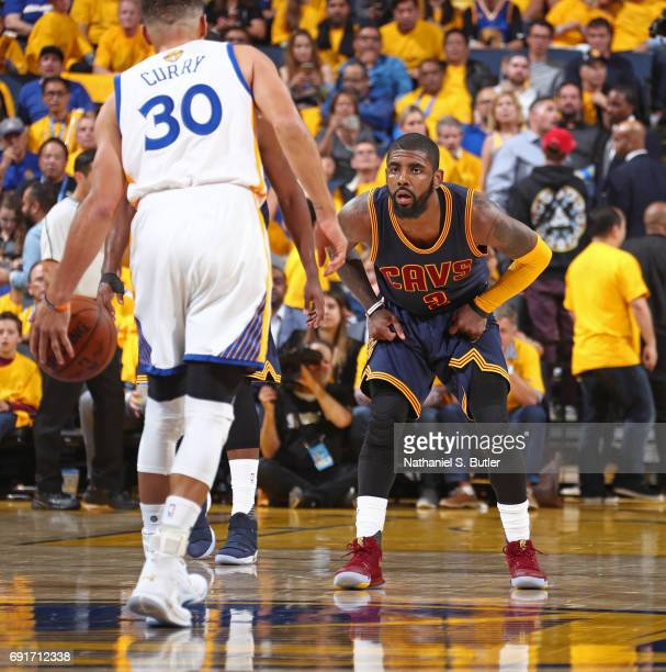 Kyrie Irving of the Cleveland Cavaliers guards Stephen Curry of the Golden State Warriors in Game One of the 2017 NBA Finals on June 1 2017 at Oracle...