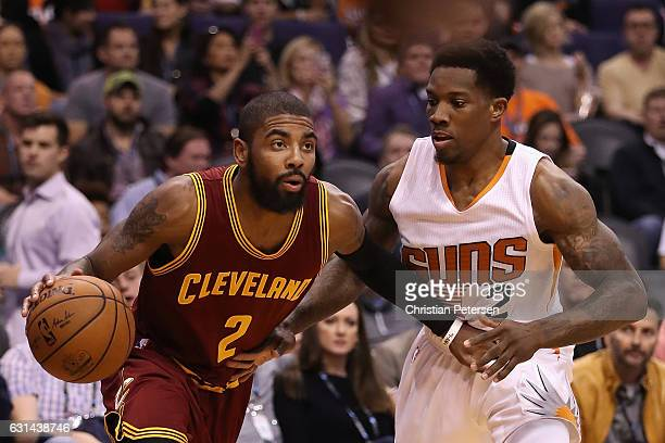 Kyrie Irving of the Cleveland Cavaliers handles the ball against Eric Bledsoe of the Phoenix Suns during the first half of the NBA game at Talking...