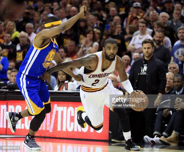 Kyrie Irving of the Cleveland Cavaliers handles the ball against Ian Clark of the Golden State Warriors in the second half in Game 3 of the 2017 NBA...