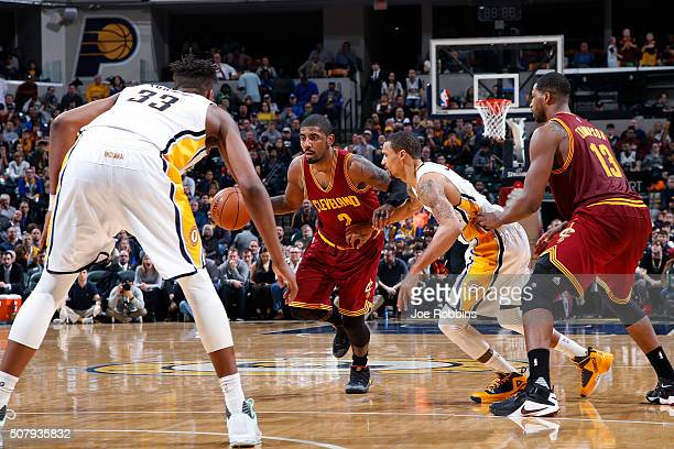 Kyrie Irving of the Cleveland Cavaliers handles the ball against George Hill of the Indiana Pacers in the second half of the game at Bankers Life...