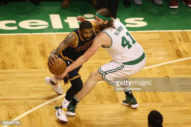 Kyrie Irving of the Cleveland Cavaliers handles the ball against Kelly Olynyk of the Boston Celtics in the first half during Game Five of the 2017...