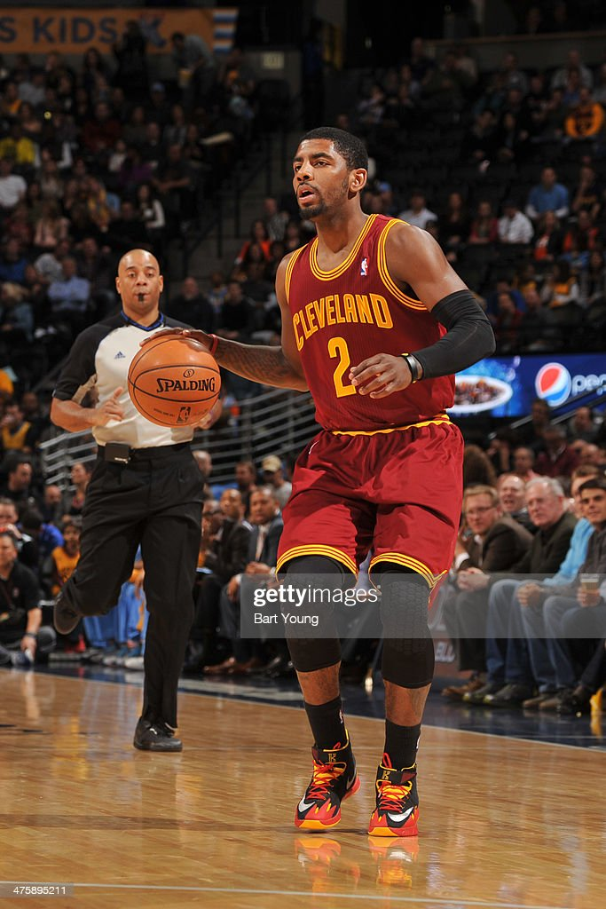 <a gi-track='captionPersonalityLinkClicked' href=/galleries/search?phrase=Kyrie+Irving&family=editorial&specificpeople=6893971 ng-click='$event.stopPropagation()'>Kyrie Irving</a> #2 of the Cleveland Cavaliers handles the ball against the Denver Nuggets on January 17, 2014 at the Pepsi Center in Denver, Colorado.