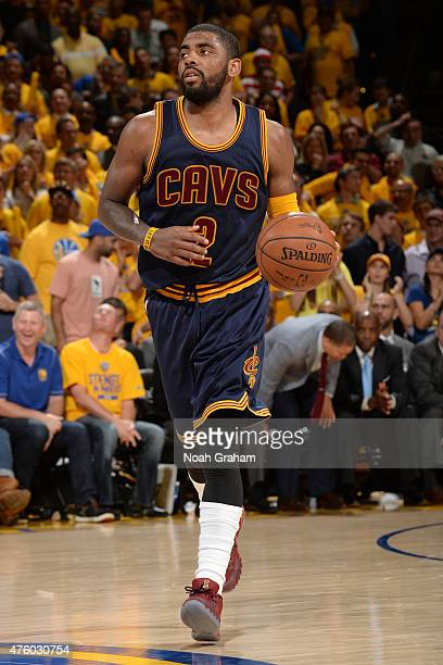 Kyrie Irving of the Cleveland Cavaliers handles the ball against the Golden State Warriors in Game One of the 2015 NBA Finals on June 4 2015 at...