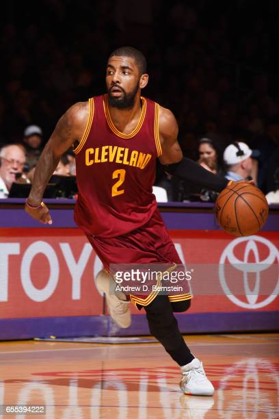 Kyrie Irving of the Cleveland Cavaliers handles the ball against the Los Angeles Lakers on March 19 2017 at STAPLES Center in Los Angeles California...