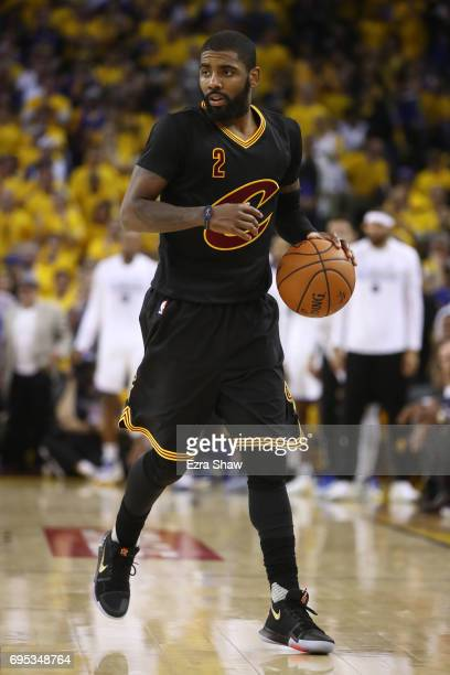 Kyrie Irving of the Cleveland Cavaliers handles the ball against the Golden State Warriors during the first half in Game 5 of the 2017 NBA Finals at...