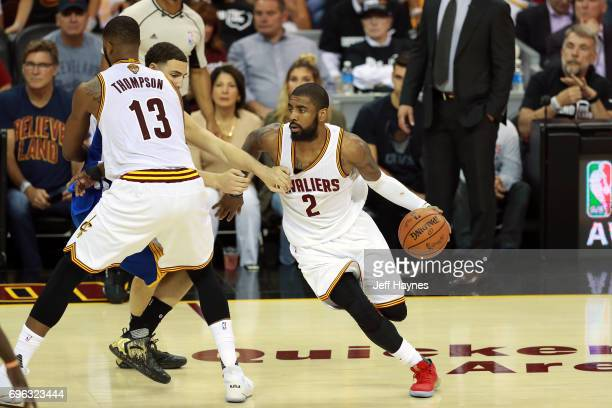 Kyrie Irving of the Cleveland Cavaliers handles the ball against the Golden State Warriors in Game Four of the 2017 NBA Finals on June 9 2017 at...