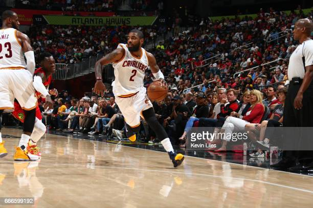 Kyrie Irving of the Cleveland Cavaliers handles the ball during a game against the Atlanta Hawks on April 9 2017 at Philips Arena in Atlanta Georgia...