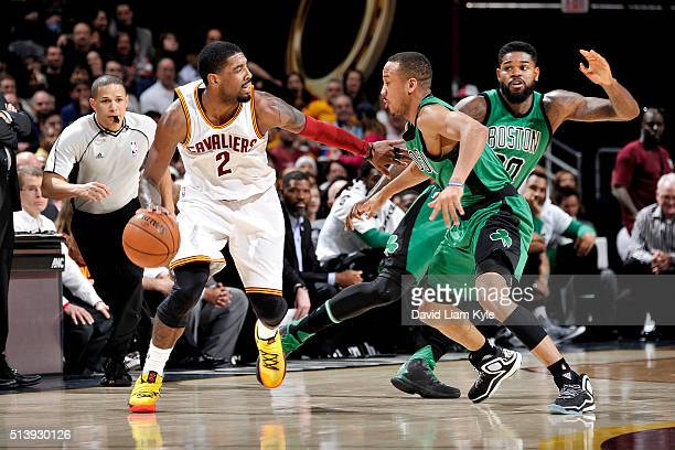 Kyrie Irving of the Cleveland Cavaliers handles the ball during the game against the Boston Celtics on March 5 2016 at Quicken Loans Arena in...