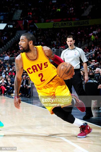 Kyrie Irving of the Cleveland Cavaliers handles the ball during the game against the Atlanta Hawks on March 3 2017 at Philips Arena in Atlanta...